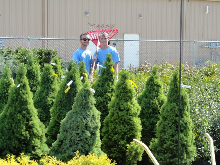 [Image: Jacob and Chase are working in the shrub area keeping the lot nice and organized]