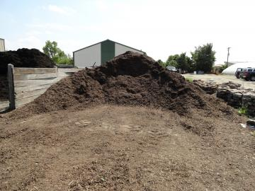 Adams Nursery & Landscaping sells brown hardwood mulch in bulk and by the bag.
